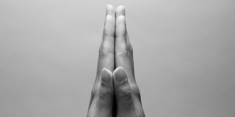 hands clasped in thanks or prayer